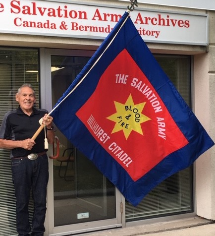 Wayne with Hillhurst flag at archives 3